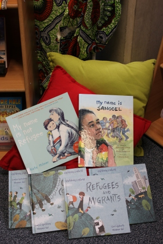 Picture books, amongst them 'My name is not Refugee' and 'My name is Sangoel'.