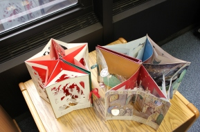 Two pop-up books unfolded to two stars with five points.