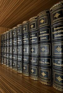 Encyclopaedia in large volumes, in black leather with golden lettering and ornamentation.