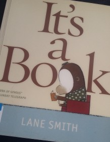 Book cover: quirky drawing of cartoon character reading a book.