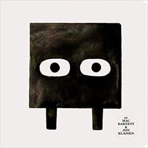 Cover of square book showing a black square with big eyes.
