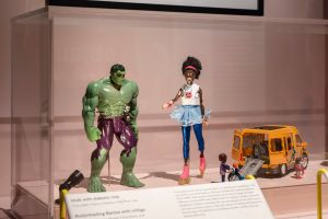 Hulk with diabetes device, Black Barbie with discoloured skine, playmobil figure in wheelchair.