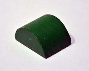 Simple green toy block in the shape of a vault.