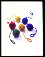 Simple fabric toys: colourful knitted balls with loops.