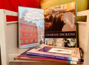 Selection of children's books and textbooks relating to Charles Dickens.