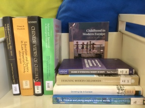 Library trolley with books on history of childhood in Europe, China, etc.